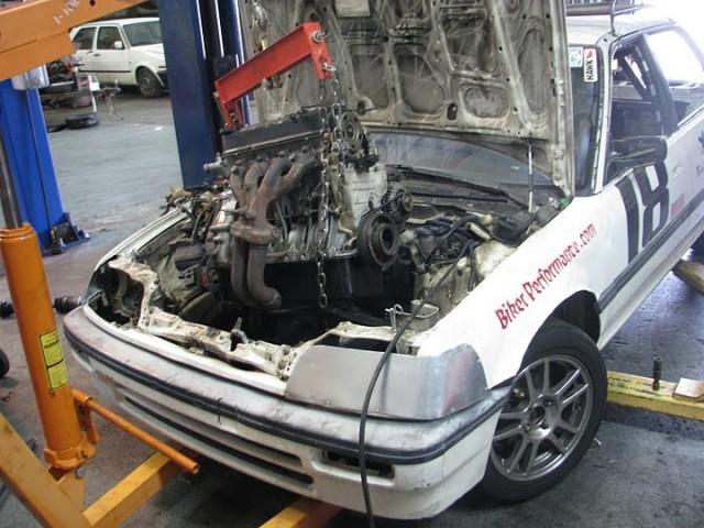 Team White Lightning's #18 car undergoing minor surgery