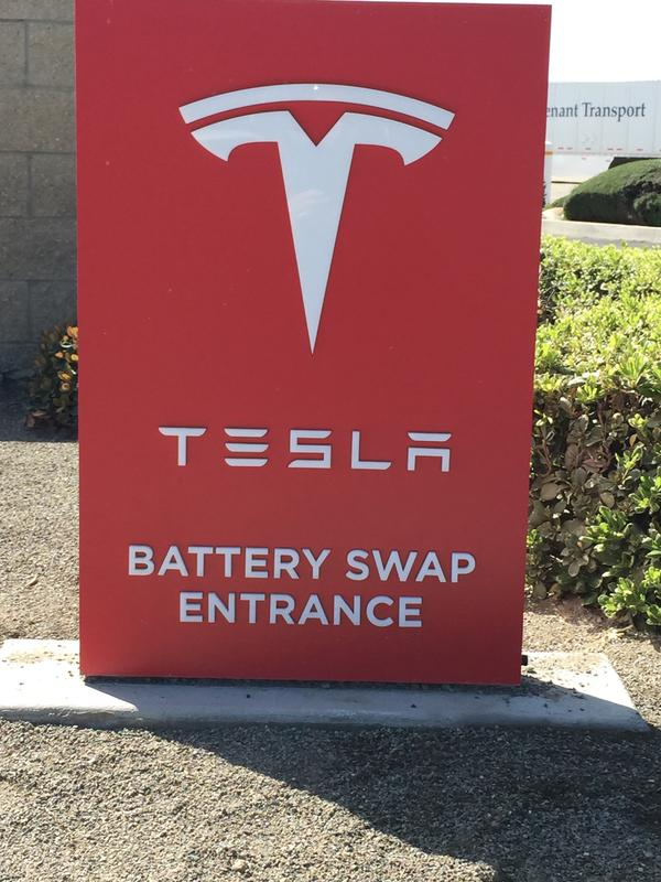 Tesla Battery Swapping sign, Harris Ranch, California, March 2015 [photo: Lenn Goodside]