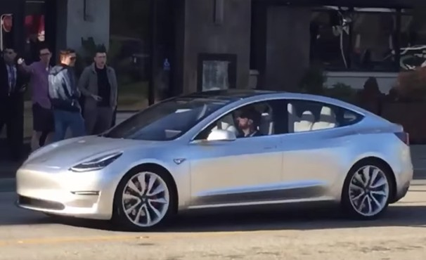 Tesla Model 3 Driving on a Public Road