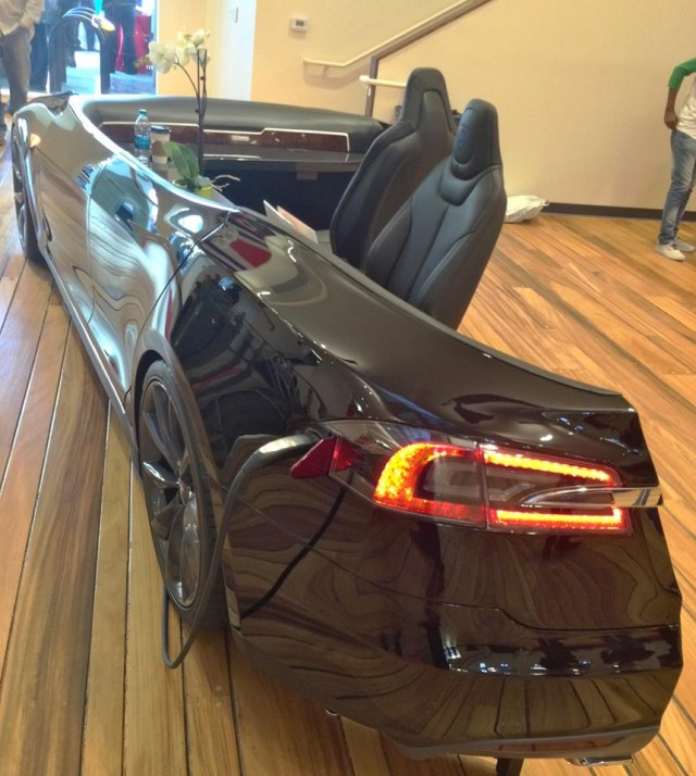 Tesla Model S electric car used as reception desk, Draper University Hero City [via Steve Jurvetson]