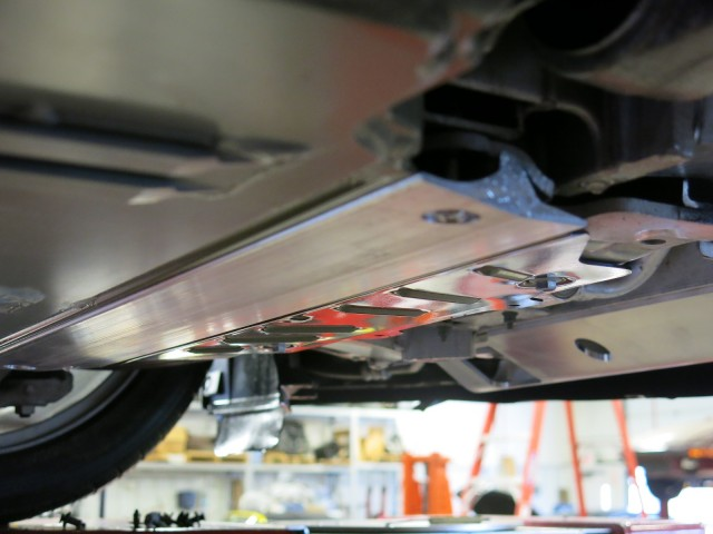 Tesla Model S added battery shield components - side view of T-section, aluminum half-tube in front
