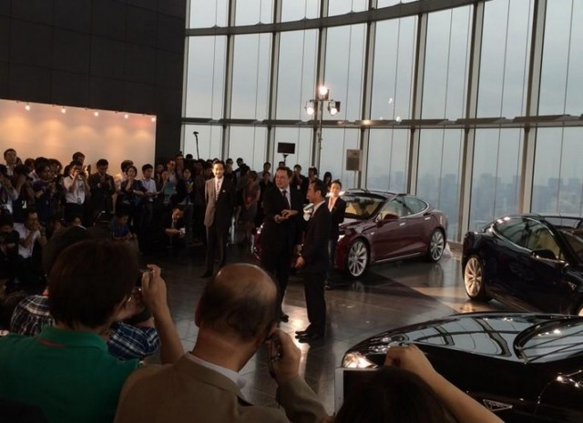 Tesla Motors CEO Elon Musk delivers first Tesla Model S electric cars in Tokyo, Sept 2014