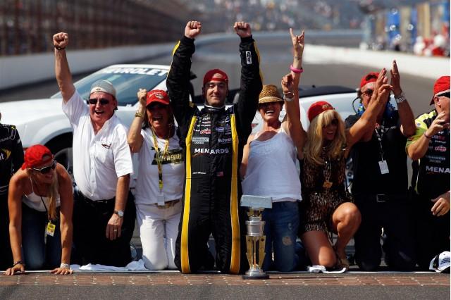 The Menard team and family celebrate after winning the Brickyard 400. Image via NASCAR.