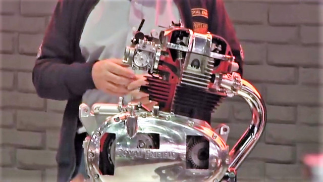 The new 650cc twin-cylinder engine is shown in a cutaway model