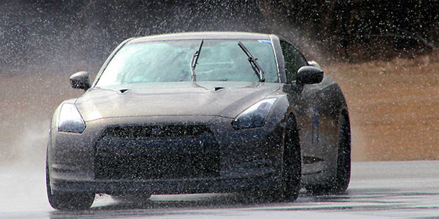 The race-winning 42 Autosports Nissan GT-R of Rankins and Taylor in action on a rain-soaked track