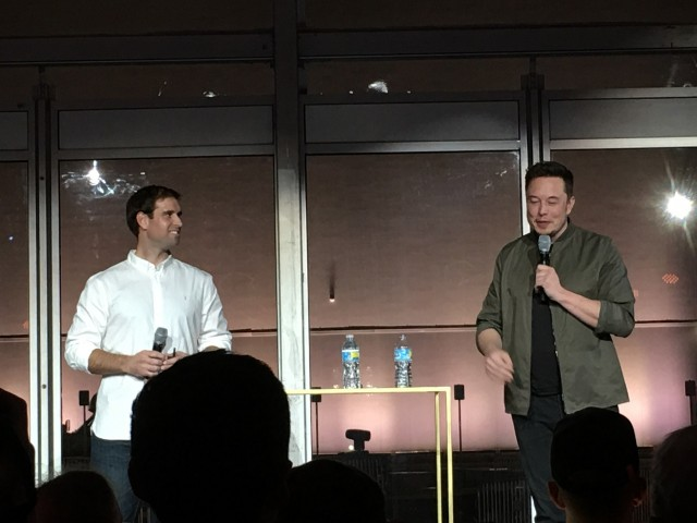 Tesla CTO JB Straubel and CEO Elon Musk presenting at gigafactory tour, Reno, Nevada, July 2016