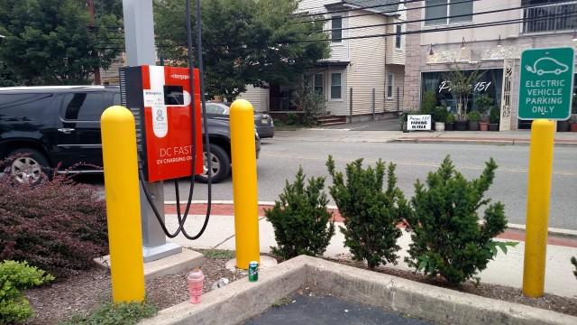 Trash left at public electric-car charging station [photo: Tom Moloughney]