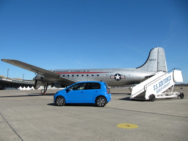 Volkswagen e-Up electric car with Douglas C54 transport plane at Berlin's Tempelhof Airport