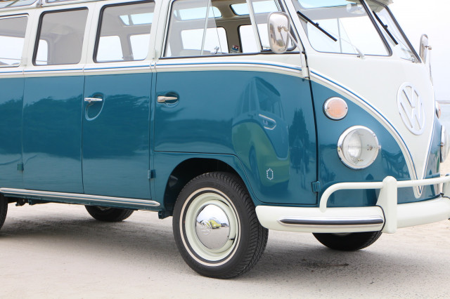 Volkswagen ID Buzz electric bus concept reflected in door of 1964 VW Microbus