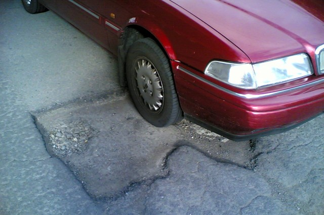 Volvo on pothole - flickr user comedy_nose
