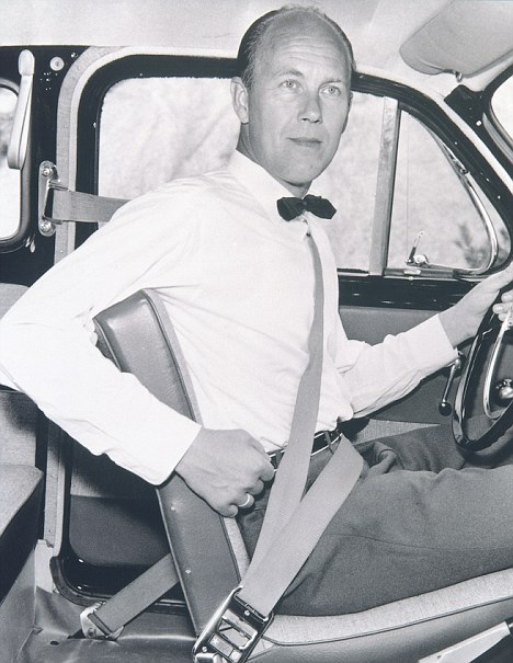 Volvo's first safety engineer, Nils Bohlin, demonstrates the three-point safety harness in 1959
