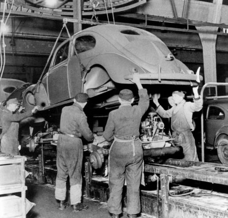 Workers assemble a Beetle after the British started production