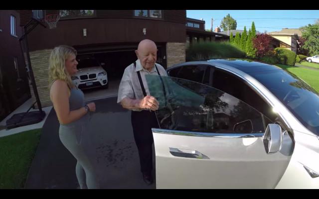 Zev Vitalis's grandfather opens the door of Zev's Tesla Model S electric car