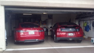 2013 Tesla Model S and 2011 Chevrolet Volt in garage; photo by George Parrott