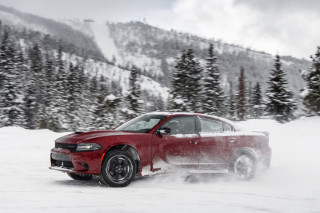 2020 Dodge Charger GT AWD kicks up snow at the Winter Driving Encounter in Winter Park, CO.
