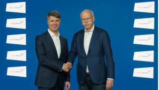 BMW Group CEO Harald Krüger (left) and Daimler CEO Dieter Zetsche