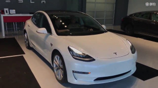 "Frame from delivery video for ""first 2017 Tesla Model 3 in Texas"""