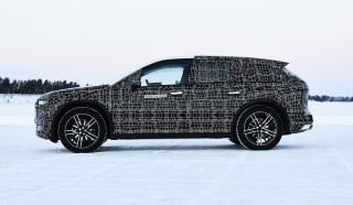 BMW reveals prototype iNext electric SUV in winter testing