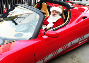 Santa In A Tesla Roadster