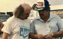 Thermos (in Hat) discusses NOS with a customer at an event
