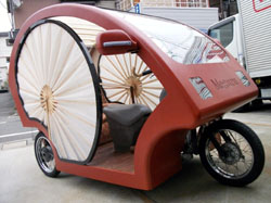 Three-seat, three-wheeled electric vehicle in traditional Japanese style, photo by Kyodo Photo.